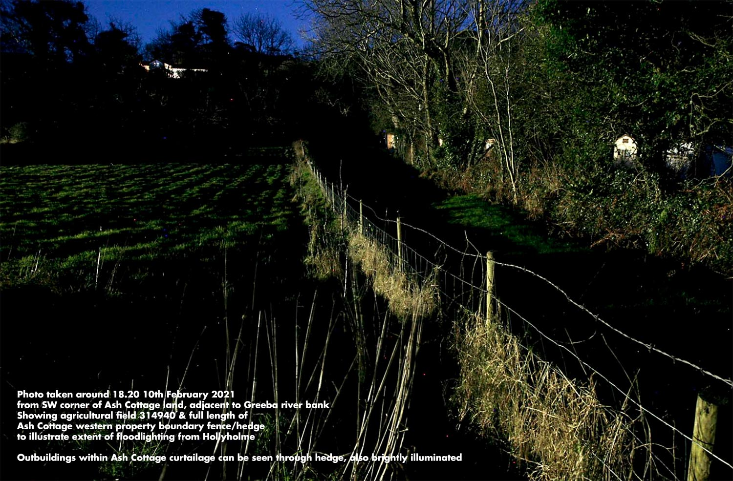 From SW corner of Ash Cottage land, adjacent to Greeba river bank. Showing agricultural field 314940 & full length of Ash Cottage western property boundary fence and hedge to illustrate the extent of floodlighting from Hollyholme